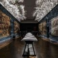 50,000 metal triangles make up undulating Foil installation, which casts light onto the V&A's medieval tapestries