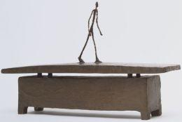 Alberto Giacometti: Walking Quickly Under The Rain